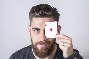 Man with ace of hearts.
