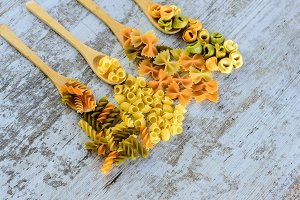 Colorful pasta served in spoon