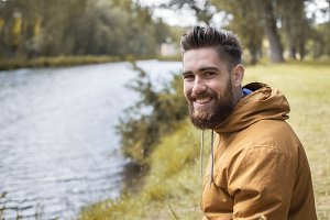 Caucasian man smiling.