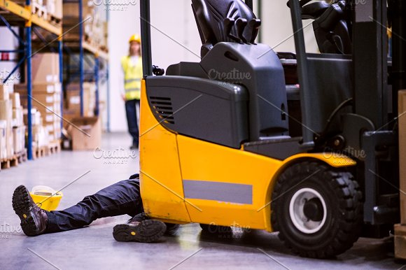 An Injured Worker After An Accident In A Warehouse