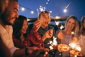 Group of friends with sparklers