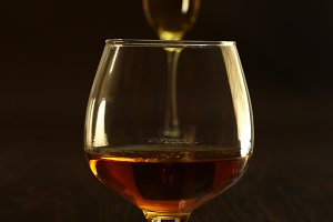 Two glasses of brandy or cognac.