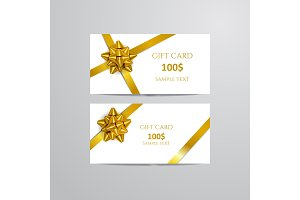 Gift Cards With gold Bow And Ribbon.
