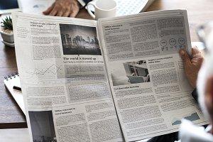 Businessman reading newspaper (PSD)
