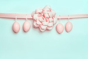 Easter eggs on ribbon with bow