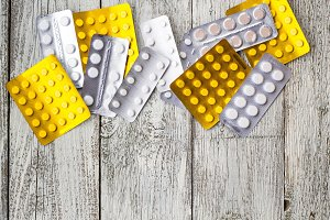 medicine pills in packs.Pills in blister pack,Capsules and pill packed in blisters on white wooden background