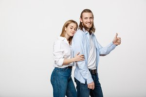 Portrait of Happy Young Couple Showing Thumb Up Isolated On White Background