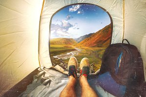 Hiker Man sits in a tourist tent wit