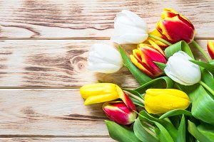 Tulips on wooden table. Flower background.