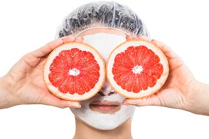 Girl with fruit mask on face