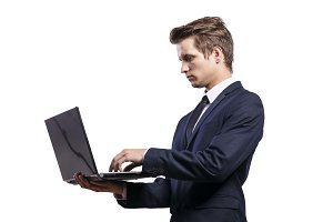 Young handsome businessman with notebook