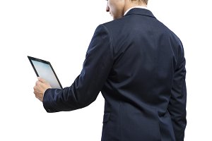 Young handsome businessman with tablet