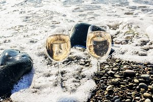 Two glasses of wine in sea waves