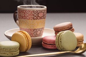 Multicolored macaroons and coffee.