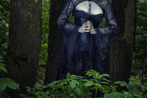 Gothic woman in the forest.