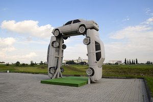 Homemade sculpture of three cars. Monument to the cyrillic lette