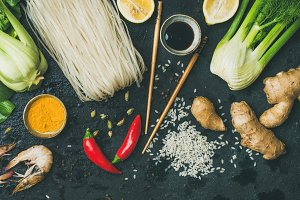 Asian cuisine ingredients over dark