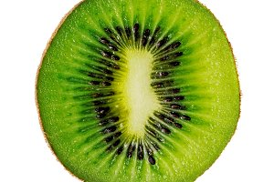 Slice of kiwi isolated on white