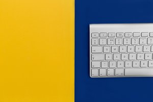 Computer keyboard yellow background