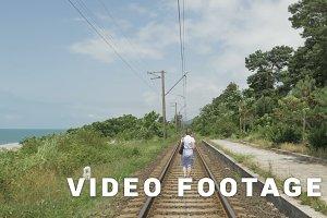 Young girl walks on the railway. Georgia