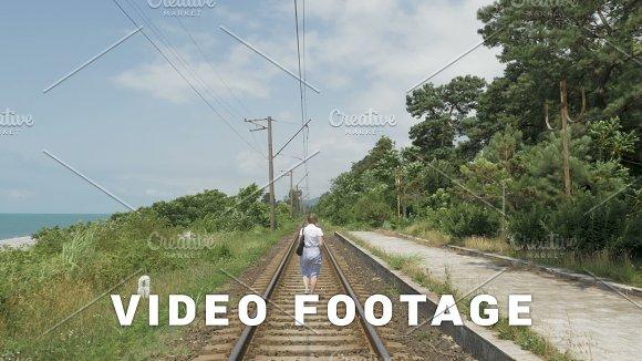Young Girl Walks On The Railway Georgia