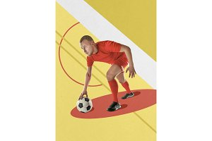 Professional football soccer player with ball on colorful background
