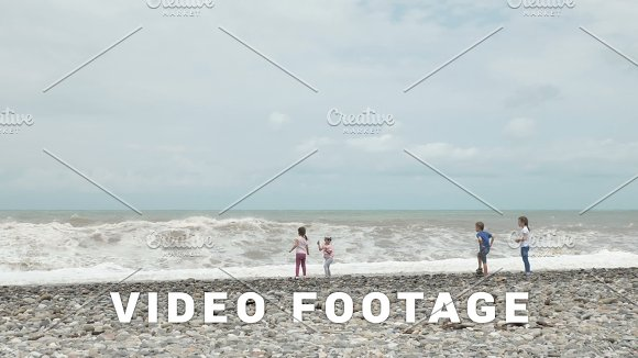 Children plays with high waves of sea - Batumi, Georgia