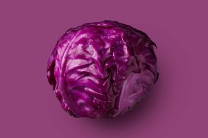 Red cabbage head isolated on purple background