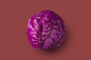 Raw red cabbage presented on a red