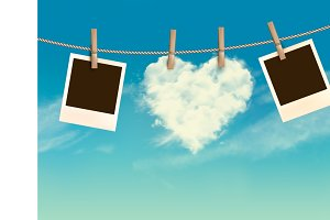 Heart shaped cloud on rope and photo