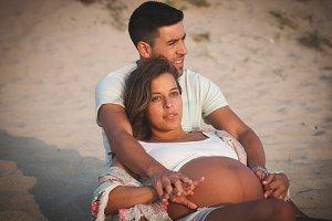 Happy Pregnant couple on beach