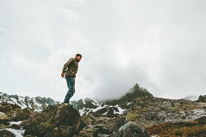 Traveler Man at foggy mountains