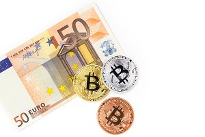 Bitcoins and fifty euro banknote