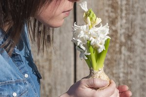 Woman smelling a hyacinth flower