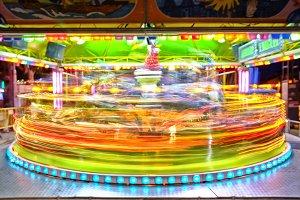 Lit carousel in motion