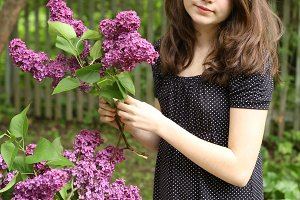 teenager girl with polka dot dress with lilac flowers