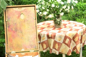 easel with paints on the green garden background with jasmin bouquet i