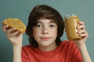 teenager boy with peanut butter and bread