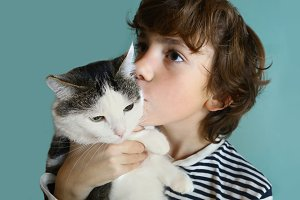 teenager boy hug cuddle with cat