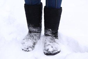 boots close up photo on snow park background