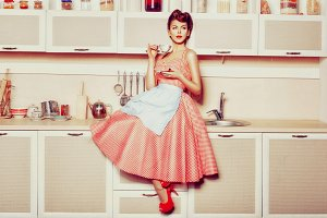 Woman in the kitchen in retro style.