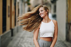 Blond woman moving her long hair