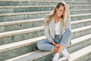 Blond woman smiling on steps