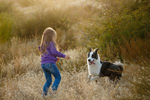 A little girl and a dog.