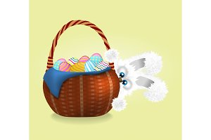 Fluffy easter bunny is looking out. Wicker basket full of decorated and painted easter eggs
