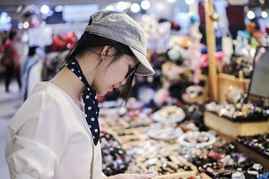 Beautiful woman shopping in festival