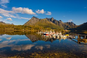 Fishing boats and yachts on Lofoten islands in Norway