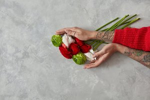 bunch of different flowers in the hands of a girl