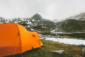 Tent camping in mountains landscape