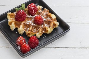 Waffle with cream strawberries